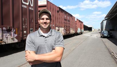 man standing beside a train