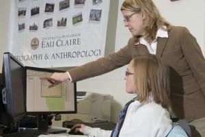 woman pointing at computer screen
