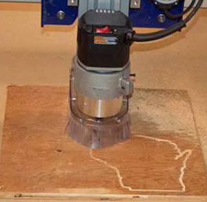 computer-controlled router carves the outline of Wisconsin into a piece of wood