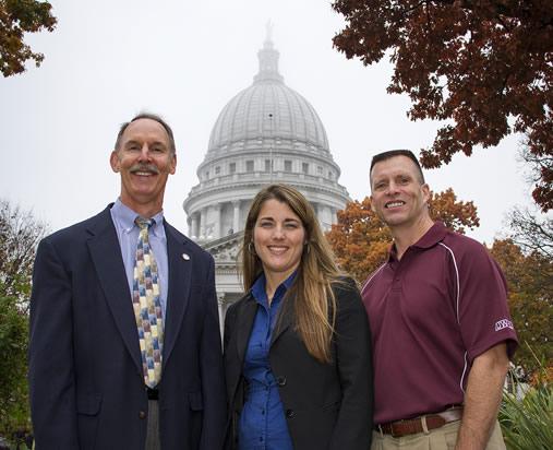 UW-La Crosse alumni standing in front of the Capitol building