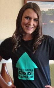 "Female UW-Stout graduate wearing a shirt displaying the phrase ""This is what a scientist looks like"""