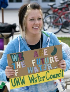 "student carrying sign with the words, ""We are the future of water"""