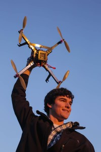 Mitchell Fiene holding up his quadcopter