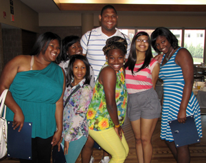 Students pose with program adviser Sir Aaron Mason.