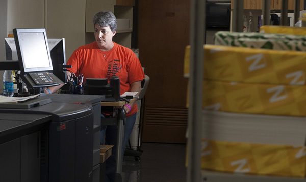 UW-Eau Claire Printing Services technician Tina Wolfgram at work