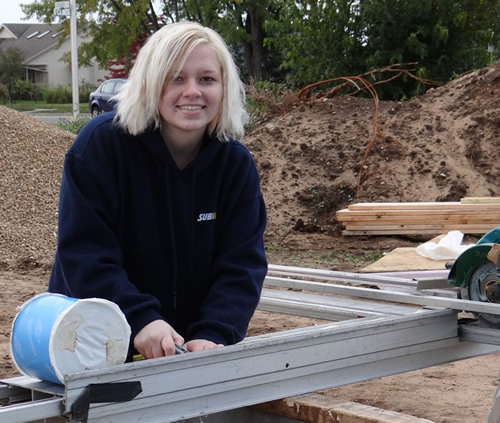 female student working on an outdoor project for Habitat for Humanity