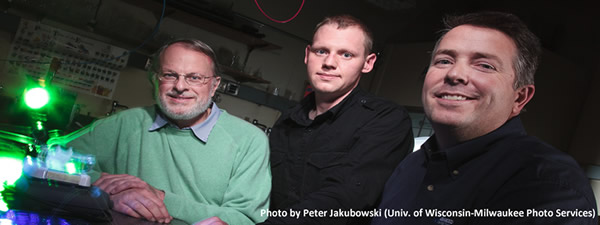 three men posing in a lab