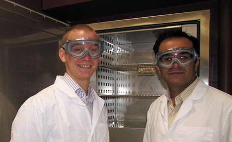 Cameron Volbrecht and Assistant Professor Naveen Chikthimmah in their lab gear