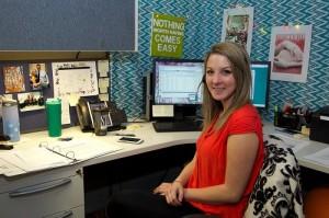 Recent graduate Jessie Fecteau at her desk