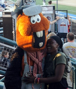 Ruka hugs and laughs with Trax the mascot