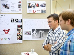 industrial design students reviewing their projects