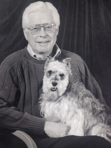 Portrait of James R. Underkofler with his little jack russell terrier.