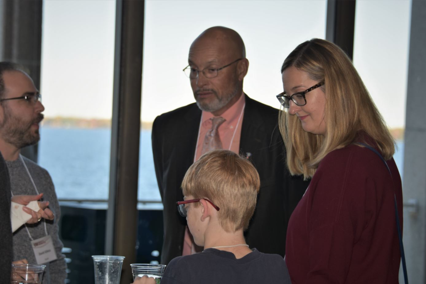Provost Dennis Shields and Amanda Tucker with a boy