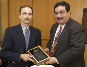 Keith Rice receives his 2002 teaching award from Regent Jose Olivieri.