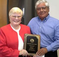 Janna Cowen receives her 2003 teaching award from Regent Jesus Salas.