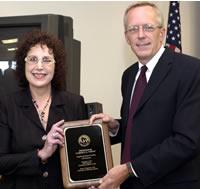 Carole Vopat receives her 2003 teaching award from Regent Charles Pruitt.