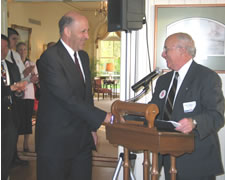 Gov. Jim Doyle (left) thanks Regent President Toby Marcovich for his remarks at a reception on Thursday in honor of the UW System's contributions toward the state's economic development.
