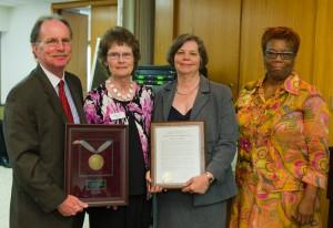 Senior VP Rebecca Martin accepts a resolution of appreciation