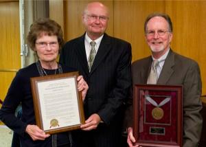 Regent Tom Loftus (center)