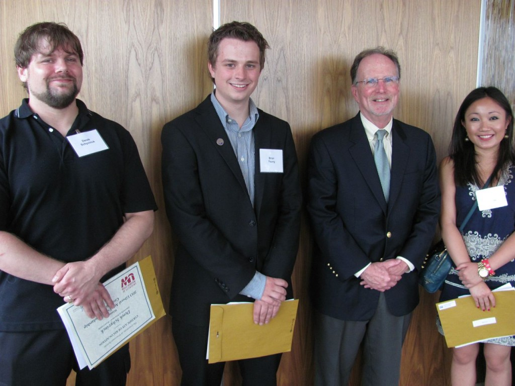 From left: Derek Schyvinck, Brian Young, President Reilly, and Ran (Laura) Luo