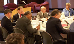 Regent President Marcovich (back, right from center) addresses the board at Friday's meeting.