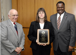 UW-Milwaukee's Pamela Fendt accepts her 2004 Academic Staff Excellence Award from Regent President Toby Marcovich and Regent Gerard Randall. (Jay Salvo)