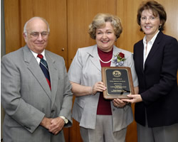 UW-La Crosse's Deon Nontelle accepts her 2004 Academic Staff Excellence Award from Regent President Toby Marcovich and Regent Eileen Connolly-Keesler. (Jay Salvo)