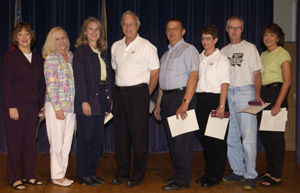 President Lyall recognizes staff with 25 or more years of service. Pictured: (left to right) Sharon Wilhelm, Sandy Erdmann, Debbie Durcan, George Brooks, Ron Weidemann, Sandy Gullickson, Gary Prisbe, and Deb Mergen. Not shown: Alan Schultz and Amy Calvillo. (Jay Salvo photo)