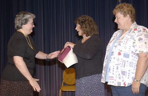 President Lyall recognizesTerri Reda (center) and Judy Hatlen for 30 years of service. (Jay Salvo photo)
