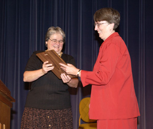 President Lyall (left) presents the 2002 UW System Eugene Craven Award to Betsy West, special assistant in the Office of Academic and Student Services (Jay Salvo photo)