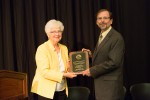 Prof. Mark Bergland, department chair of UW-River Falls Department of Biology, accepts award from Regent Farrow