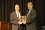 Clifton Ganyard (right), UW-Green Bay, accepts award from Regent Pruitt
