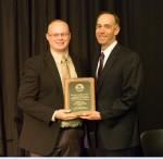 Matthew Roberts, UW-Platteville (right) accepts award from Regent Landes