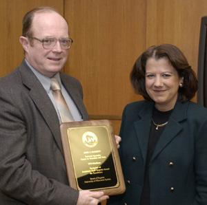 John Gugerty accepting award