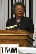 Marrett speaking at the podium