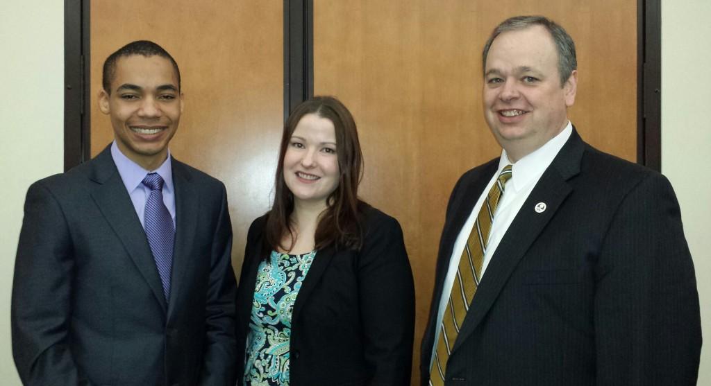 Rhodes Scholar Tayo Sanders, his mentor Dr. Jennifer Dahl, and UW-Eau Claire Chancellor James Schmidt