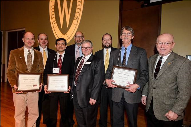From left to right in the front row, Regents Scholar award recipients Joseph Hupy, Mohammed Rabbanni and Tovio Kallas are pictured with Regent Mark Tyler and President Ray Cross during a UW System Board of Regents meeting held at Union South at the University of Wisconsin-Madison on Feb. 4, 2016. In the background, from left to right, are chancellors Jim Schmidt (UW-Eau Claire), Dennis Shields (UW-Platteville) and Andy Leavitt (UW-Oshkosh). (Photo by Jeff Miller/UW-Madison)