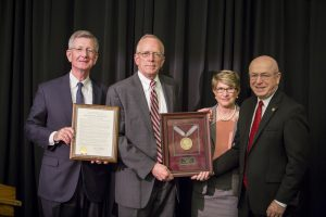 Regent Emeritus Charles Pruitt (second from right) is honored forhis years of service; also pictured (from left), Regent Bradley, Regent President Millner, and President Cross