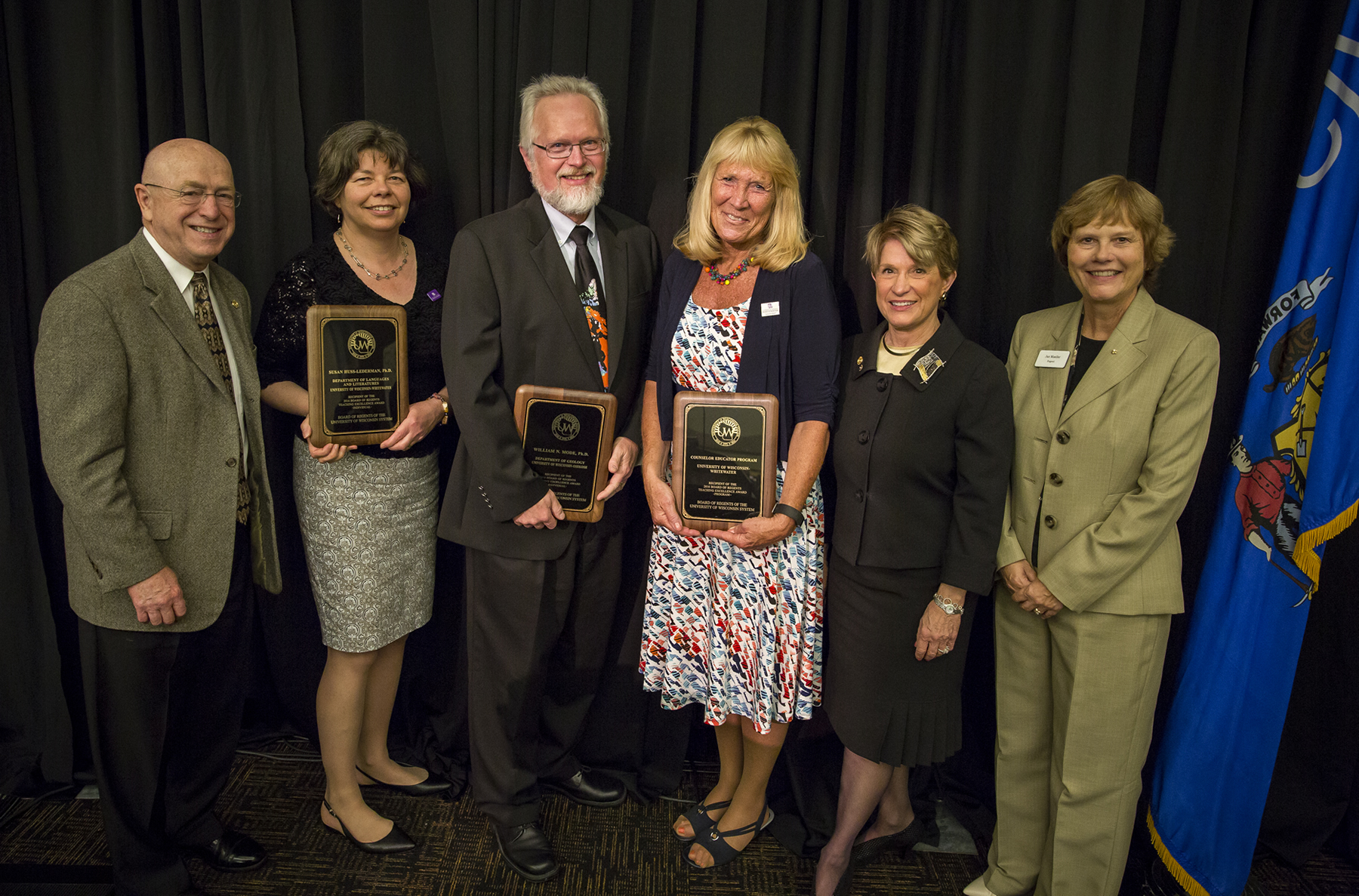 (from left) President Ray Cross, Dr. Susan Huss-Lederman, Dr. William Mode, Dr. Brenda R. O'Beirne, Regent President Regina Millner, and Regent Janice Mueller