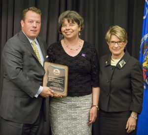 (from left) Regent Michael M. Grebe, Dr. Susan Huss-Lederman, and Regent President Regina Millner