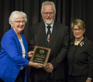 Dr. Mode (center) with Regent Farrow (left) and Regent Millner