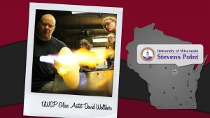 UWSP student Anna Lehner, Appleton, works with glass artist David Walthers at the university's hot glass-working studio.