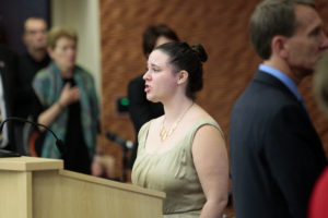 Katie Anderson, a UW-Madison music graduate student, sings the national anthem at the Regents meeting