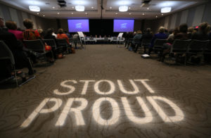 "Photo of UW-Stout conference room that hosted the Board of Regents October 2017 meeting, with ""Stout Proud"" illuminated on the floor"
