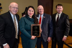 Bee Vang holds award