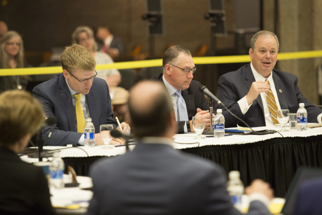 Photo of UW-Eau Claire Chancellor James Schmidt (far right)