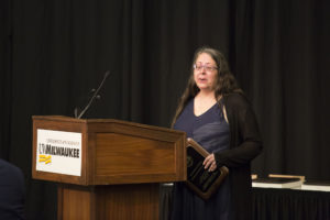 Photo of Professor Heidi Sherman accepting the 2018 Regents Teaching Excellence Award on behalf of UW-Green Bay's History Department
