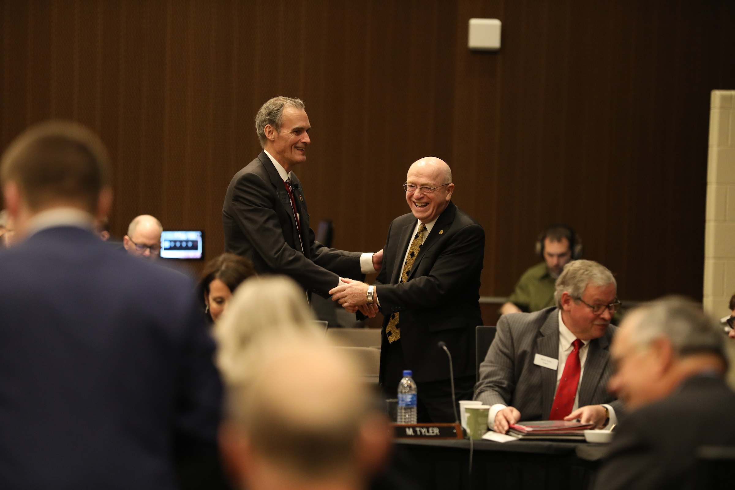 Photo of Chancellor Joe Gow and UW System President Ray Cross shaking hands during the first day of the UW System Board of Regents meeting hosted by UW-La Crosse (December 6, 2018)