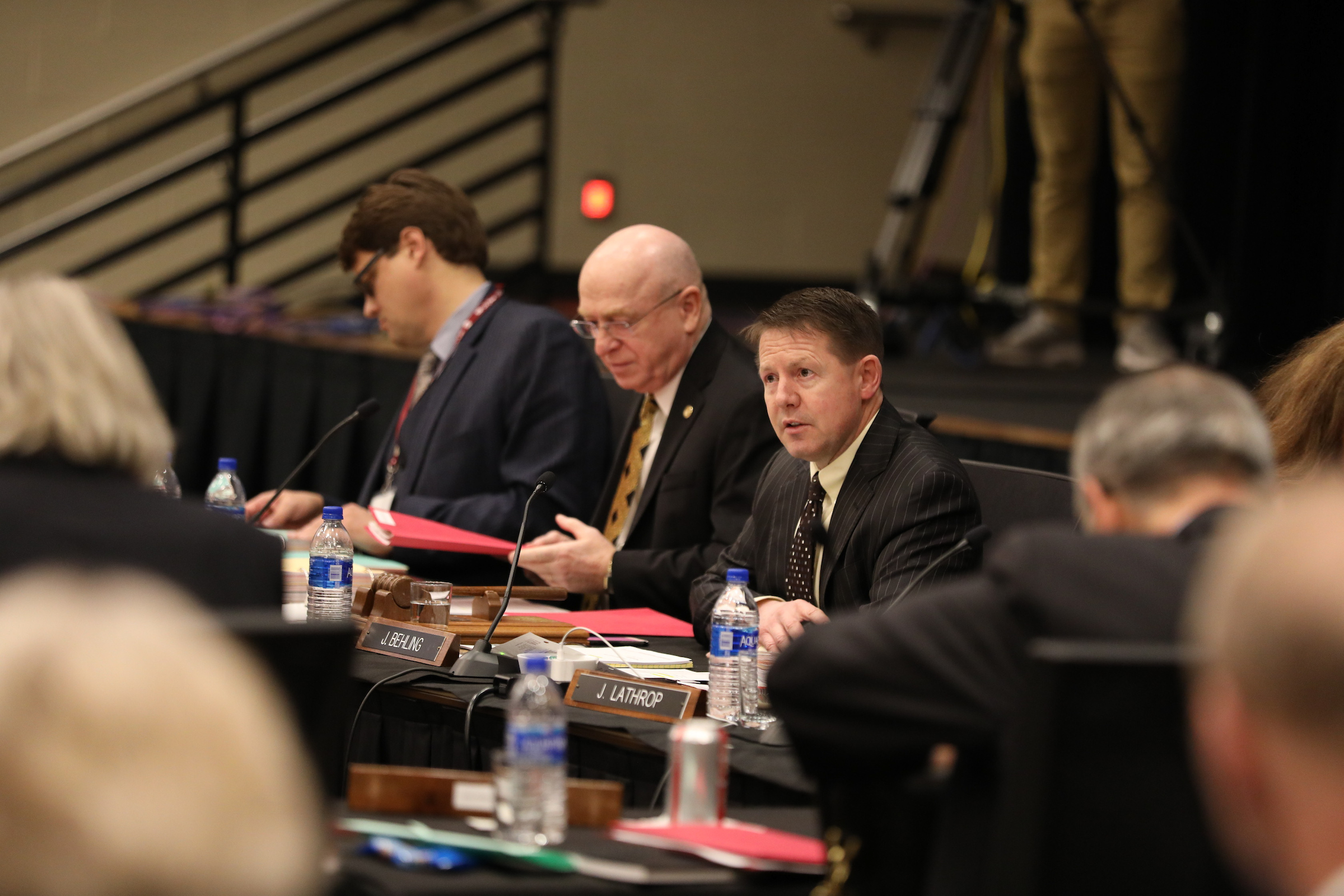 Photo of (from left) General Counsel Quinn Williams, UW System President Ray Cross, and Regent President John Robert Behling, taken at UW System Board of Regents meeting hosted by UW-La Crosse on December 6, 2018