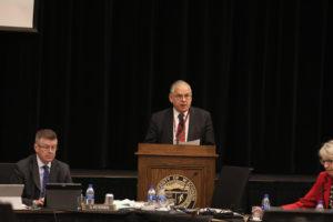 Photo of Regent José Delgado presenting UW-La Crosse a resolution of appreciation for hosting the December 6-7, 2018, Board of Regents meeting
